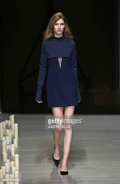 A model presents a creation from designer Marios Schwab during the 2014 Autumn / Winter London Fashion Week in London on February 16 2014 AFP PHOTO /...