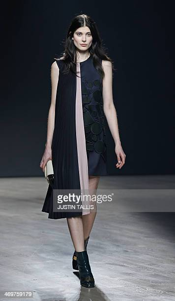 A model presents a creation from designer Mary Katrantzou during the 2014 Autumn / Winter London Fashion Week in London on February 16 2014 AFP PHOTO...