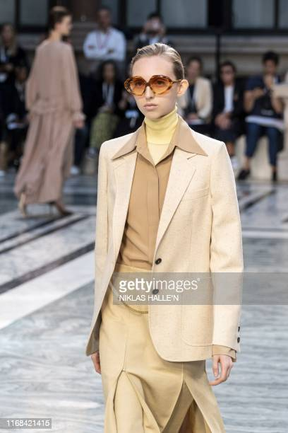 A model presents a creation from designer Victoria Beckham during a catwalk show for the Spring/Summer 2020 collection on the third day of London...