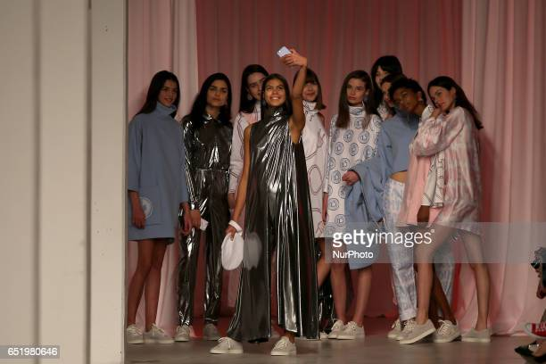 A model presents a creation from one young Portuguese Designer of the Sangue Novo collective Fall/Winter 2017/2018 collection during the Lisbon...
