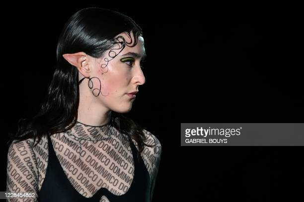 Model presents a creation from Spanish designer Dominnico's Spring/Summer 2021 collection during the Mercedes Benz Fashion Week in Madrid on...