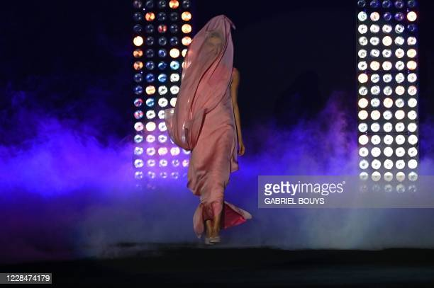 Model presents a creation from Spanish designer Maison Mesa's Spring/Summer 2021 collection during the Mercedes Benz Fashion Week in Madrid on...