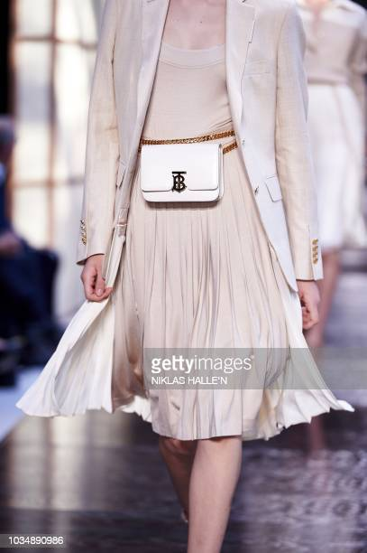 A model presents a creation from the Burberry collection during a catwalk show for the Spring/Summer 2019 collection on the fourth day of London...