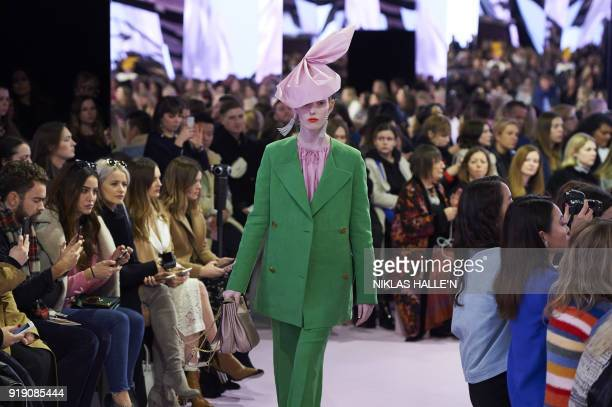 A model presents a creation from the Mulberry collection during their show on the first day of London Fashion Week Autumn/Winter 2018 in London on...
