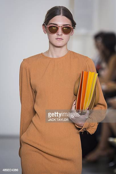 A model presents a creation from the Paul Smith collection for Spring/Summer 2016 at London Fashion Week in London on September 20 2015 TAYLOR