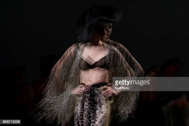 A model presents a creation from the Portuguese fashion designer Filipe Faisca Spring/Summer 2018 collection during the Lisbon Fashion Week Moda...