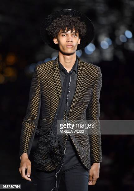A model presents a creation from the Saint Laurent Men's Spring/Summer 2019 collection during a runway show in Liberty State Park on June 6 2018 in...