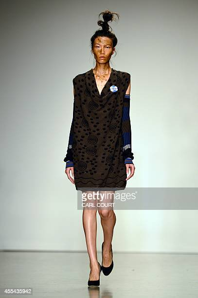A model presents a creation from the Vivienne Westwood collection during the 2015 Spring / Summer London Fashion Week in London on September 14 2014...