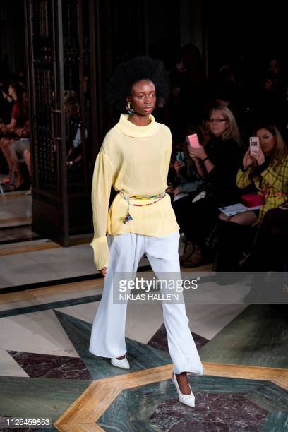 A model presents a creation from Viennese womenswear brand Kalissi during their 2019 Autumn / Winter collection catwalk show at London Fashion Week...