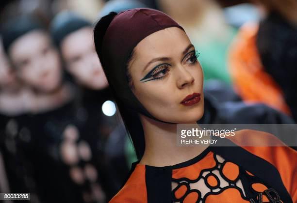 Model presents a creation Italian designer Miuccia Prada for Miu Miu during the autumn/winter 2008-2009 ready-to-wear collection show in Paris, 02...