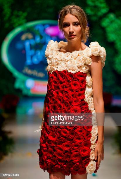 A model presents a creation made with organic elements by Colombian designer Valentina Garcia during BioFashion 2013 in Cali department of Valle del...