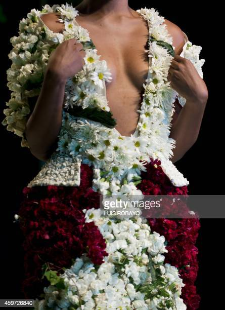 A model presents a creation made with organic elements by Colombian designer Silvia Osorio during BioFashion show in Cali Department of Valle del...