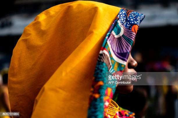 A model presents a creation of a local designer during a fashion show at the 2017 edition of the Durban July horse race in Durban on July 1 2017 /...