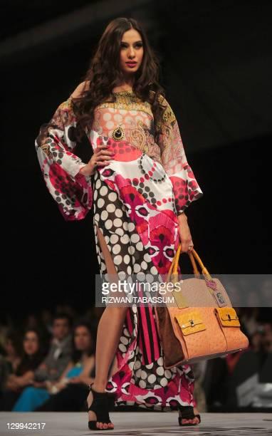 A model presents a creation of designer Ammar Belal on PFDC Sunsilk Fashion Week in Karachi on October 22 2011 AFP PHOTO/ Rizwan TABASSUM