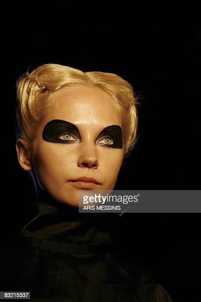 Model presents a creation of designer Demna Gvasalia during the Greek fashion week in Athens on October 10, 2008. AFP PHOTO / Aris Messinis