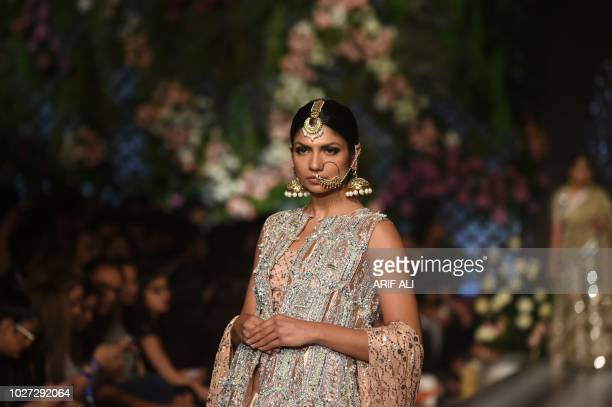 A model presents a creation of designer Nadia Azwer during the Pakistan Fashion Design Council L'Oreal Paris Bridal Week 2018 in Lahore on September...