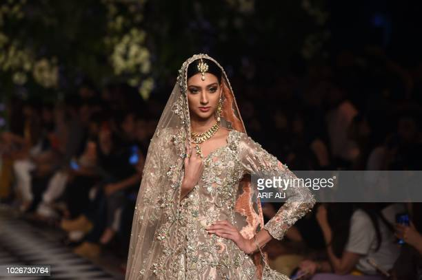 A model presents a creation of designers Rema and Shehrbano during the Pakistan Fashion Design Council L'Oreal Paris Bridal Week 2018 in Lahore on...