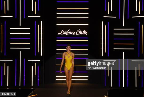 A model presents a creation of Dolores Cortes' Spring/Summer 2018 collection during the Madrid Fashion Week in Madrid on September 15 2017 / AFP...