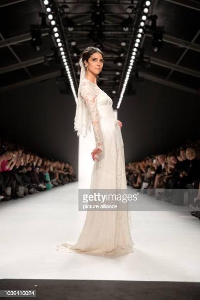 A model presents a creation of fashion designer Guido Maria Kretschmer at  the MercedesBenz Fashion Week 0357154735