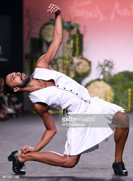 A model presents a creation of Francis Montesinos' Spring/Summer 2018 collection during the Madrid Fashion Week in Madrid on September 15 2017 / AFP...
