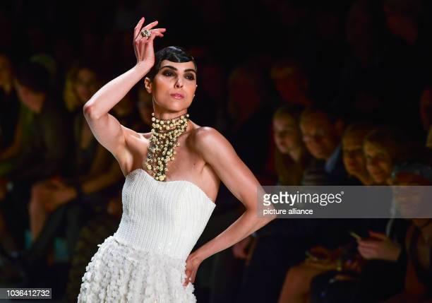 A model presents a creation of Guido Maria Kretschmer during the  MercedesBenz Fashion Week in Berlin fec168199f