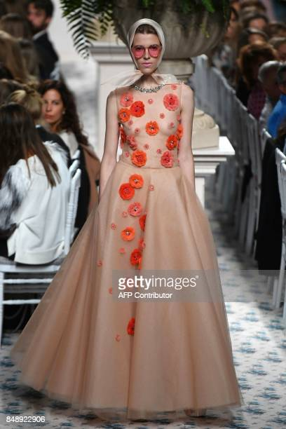 A model presents a creation of Jorge Vazquez's Spring/Summer 2018 collection during the Madrid Fashion Week in Madrid on September 18 2017 / AFP...