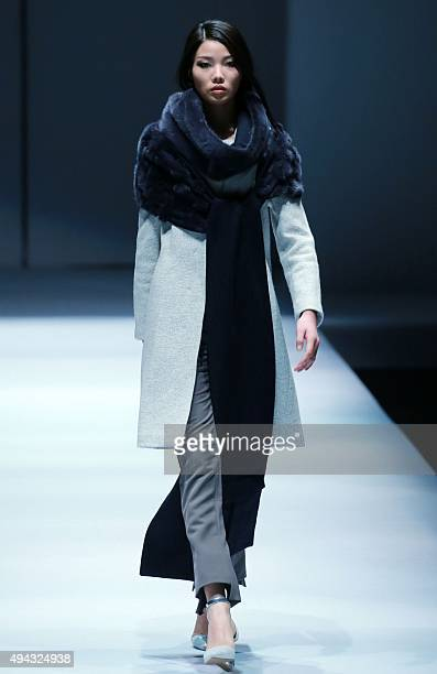 A model presents a creation of Kopenhagen Fur ELLASSAY Joint Collection at the China Fashion Week in Beijing on October 26 2015 The 9day China...