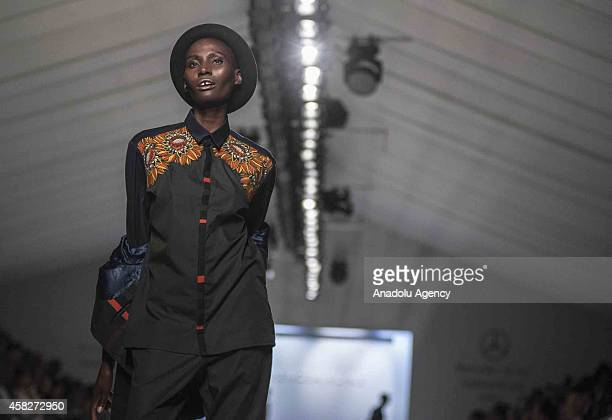 A model presents a creation of 'Laurance Airline' during MercedesBenz Fashion Week Africa at African Pride Melrose Arch Hotel in Johannesburg South...