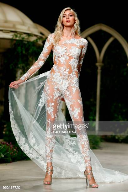 A model presents a creation of the Pronovias 2019 collection during the Barcelona Bridal Week in Barcelona on April 23 2018