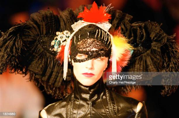 A model presents a design during the Christian Lacroix Haute Couture Autumn/Winter 20012002 fashion show July 10 2001 in Paris France