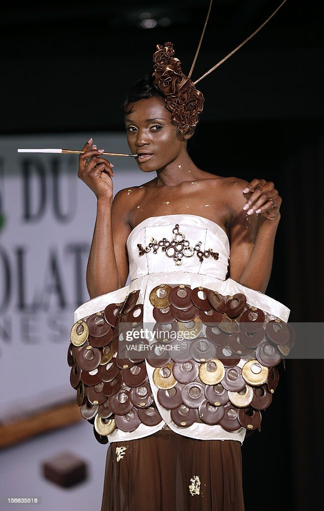 A model presents a dress made of chocolate on November 22, 2012 in Cannes, Southeastern France, during a fashion show for the inauguration of Cannes international chocolate fair