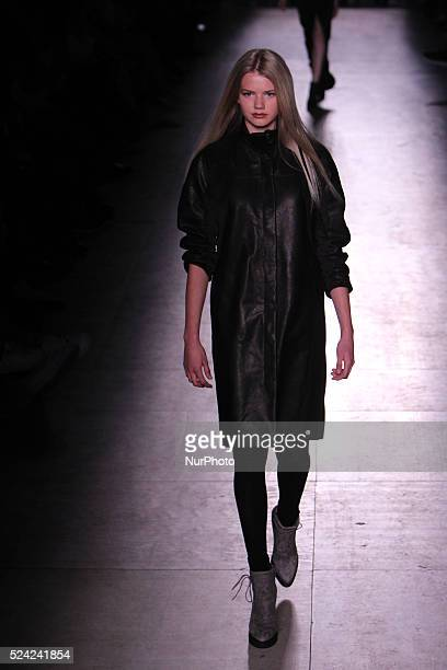 A model presents a Fall/Winter 20152016 collection creation by Serbian fashion Designer Aleksandar Protic during the 43nd edition of Moda Lisboa...