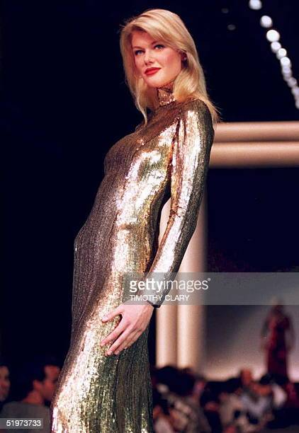 A model presents a gold sequin evening gown in the Ralph Lauren Fall 1995 fashion show in New York 05 April 1995 AFP PHOTO