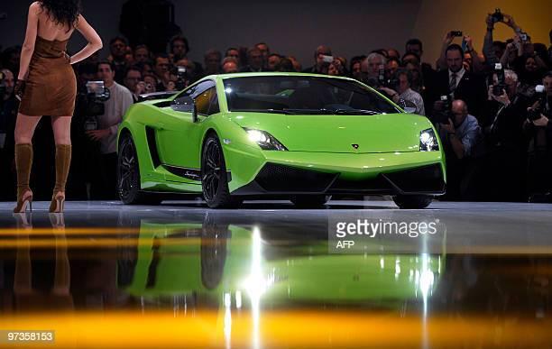 A model presents a Lamborghini Gallardo LP 5704 on March 1 at the first press day of the 80th Geneva International Motor Show at Palexpo in Geneva...