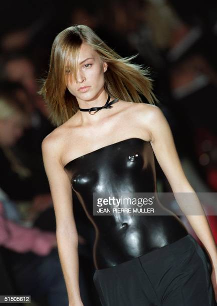 Model presents a moulded bustier by US designer Tom Ford during his first ready-to-wear show for Yves Saint Laurent 13 October 2000 in Paris at the...