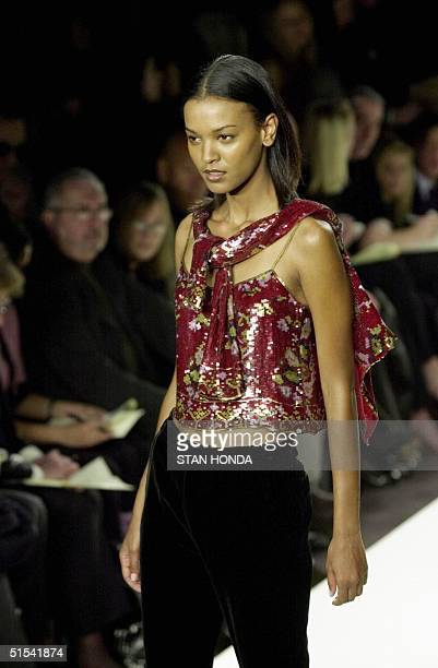 A model presents a patterned top over black velvet trousers during the Ralph Lauren fashion show 09 February in New York The show is part of the...