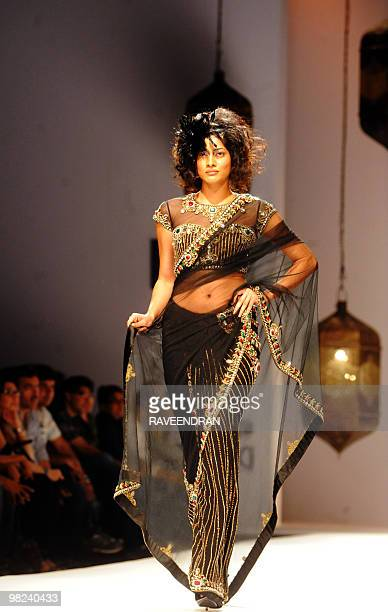 A model presents a saree by Indian designers Rabani and Rakha during the final day of the Wills India Fashion week Winter 2010 in New Delhi on March...