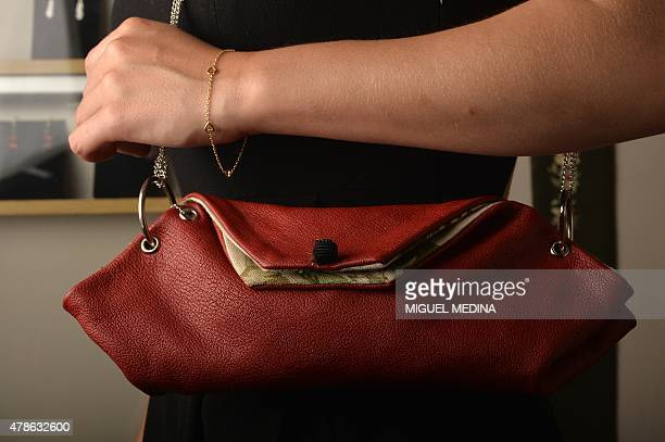 A model presents a seamless bag by French designer hat and jewelry maker and artist Valerie Drevon at her studio in Vincennes outside Paris on June...