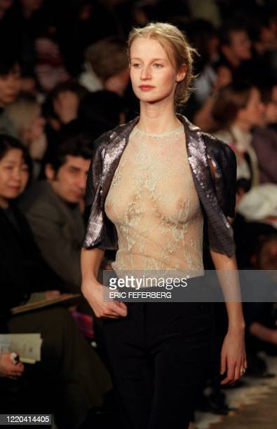 Model presents a short metallic-coloured jacket over a lacy camisole for British designer Stella McCartney's label, Chloe, during the 1999-2000...