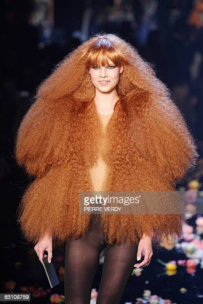 Model presents a silhouette by Belgian designer Martin Margiela in homage to French designer Sonia Rykiel after her spring/summer 2009 ready-to-wear...