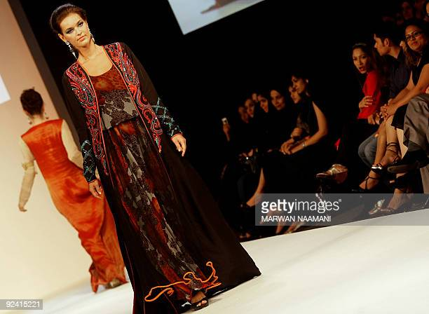 A model presents a traditonal jalabiya from the Beenas B'jouel collection by Indian designers during a fashion show in the Gulf emirate of Dubai late...