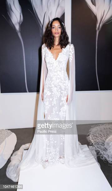 Model presents a wedding dress for Atelier Pronovians 2019 presentation during New York Bridal Week at Studio 525 Manhattan