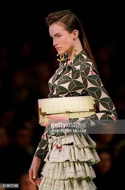 A model presents an ensemble for Chanel 15 March 2001 in Paris during the Autumn/Winter 2001/2002 readytowear collections AFP PHOTO JEANPIERRE MULLER