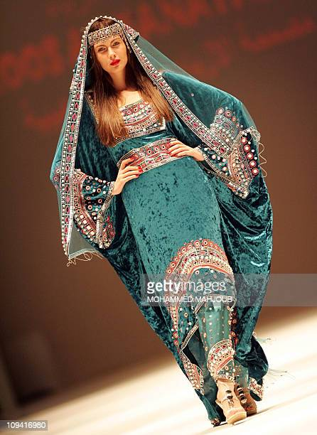 A model presents an ethnicinspired creation by Omani designer Hanaa alWahaibi during the closing ceremony of the Muscat Fashion Week in the Omani...