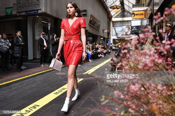 A model presents an outfit by Australian label Cue during Melbourne Fashion Week in Melbourne on August 31 2018