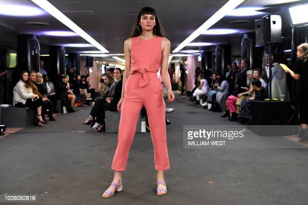 A model presents an outfit by Australian label Kuwaii in an innercity underpass during Melbourne Fashion Week on September 2 2018