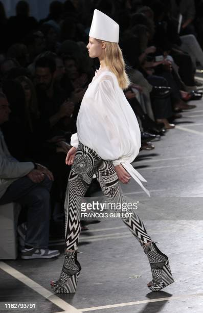 Model presents an outfit by Italian designer Riccardo Tisci for Givenchy during ready-to-wear Spring-Summer 2010 fashion show on October 4, 2009 in...