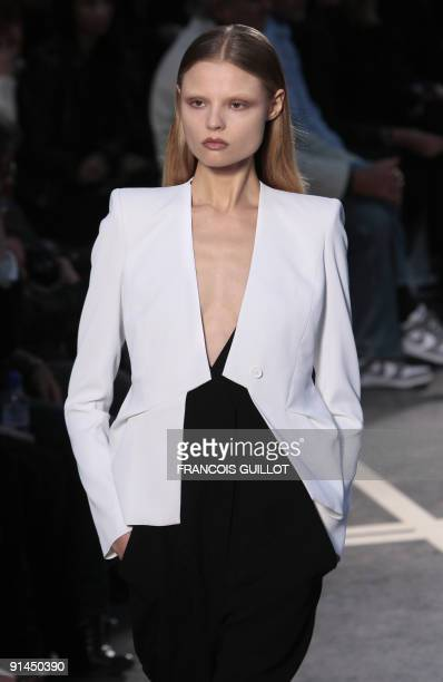 A model presents an outfit by Italian designer Riccardo Tisci for Givenchy during readytowear SpringSummer 2010 fashion show on October 4 2009 in...
