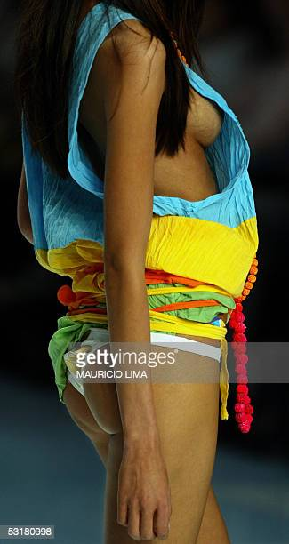 Model presents an outfit created by Movimento during 2006 Spring-Summer collection of Sao Paulo Fashion Week, in Sao Paulo, Brazil, 01 July 2005. AFP...