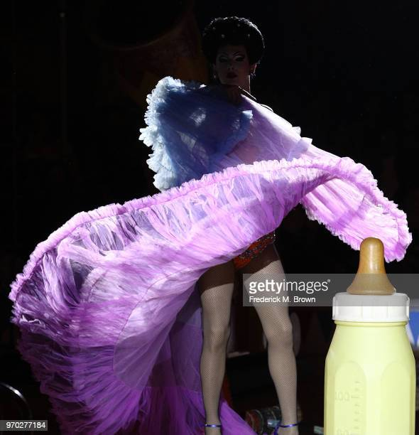 A model presents an outfit during Moschino Spring/Summer 19 Menswear and Women's Resort Collection at the Los Angeles Equestrian Center on June 8...